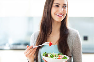 oral device for weighloss woman eating salad
