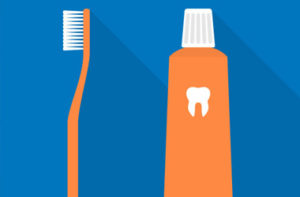 brushing teeth good for the heart orange and blue toothbrush