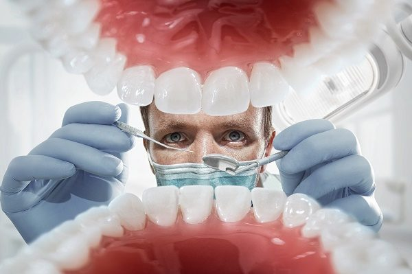 a dentist looking inside the mouth.