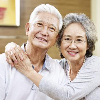 an older couple smiling together.