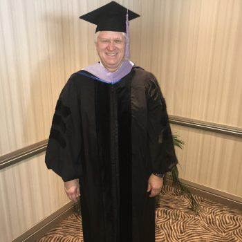 Dr. Kosinski in cap and gown for graduation