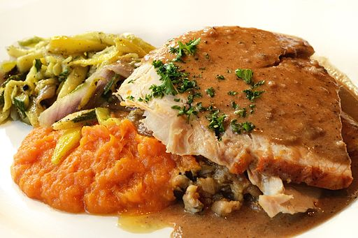 a meal with turkey, vegetables, and potatoes.